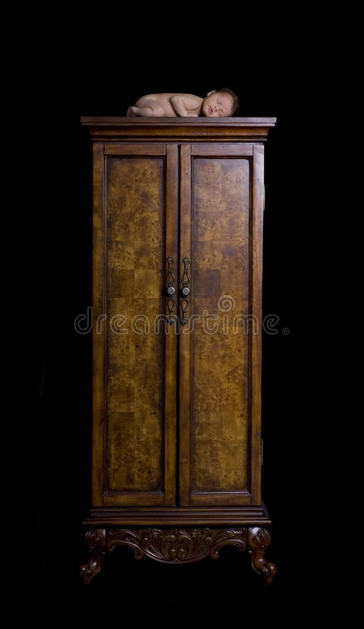 Download Newborn Sleeping Peacefully On Armoire Dressing Cl Stock Photo - Image: 13221032