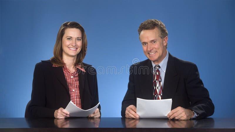 Newcasters de Smilng. images libres de droits