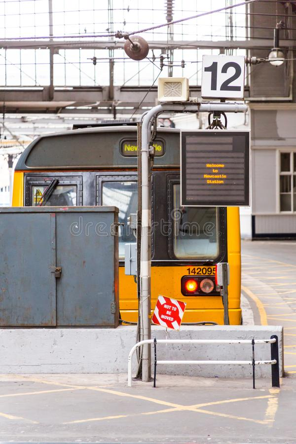 Platform 12 at Newcastle Station. Newcastle/United Kingdom - May 25, 2015: A train awaits departure on Platform 12 of Newcastle Central Station in England stock photography