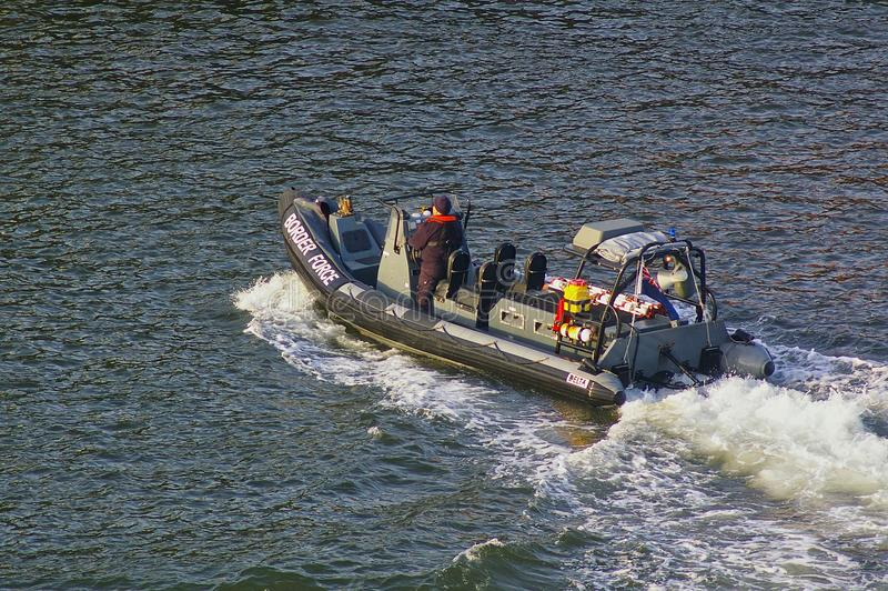 Newcastle, United Kingdom - October 5th, 2014 - UK border force RIB patrol boat with crew member. Aboard royalty free stock images