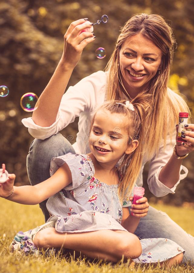 Newer boring. Little girl have play with her mother. Close up stock image