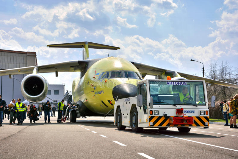 Newest transport aircraft Antonov An-178 is towed to flight test airfield, April 16, 2015 royalty free stock photo