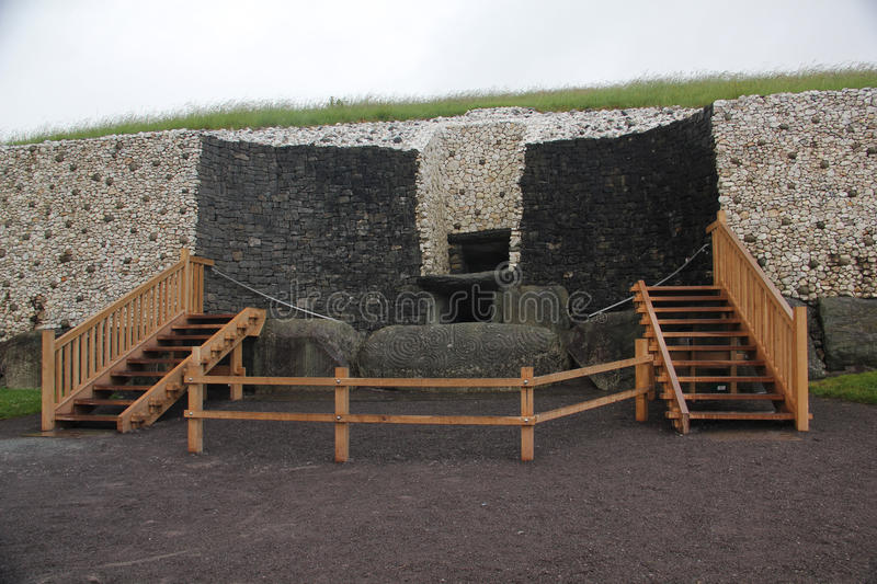 Newgrange, Ireland. Newgrange is a prehistoric monument in County Meath, Ireland, located about one kilometre north of the River Boyne. It was built during the royalty free stock image