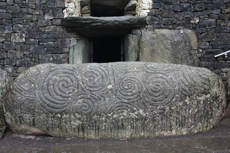 Newgrange, Ireland. Newgrange is a prehistoric monument in County Meath, Ireland, located about one kilometre north of the River Boyne. It was built during the stock photography