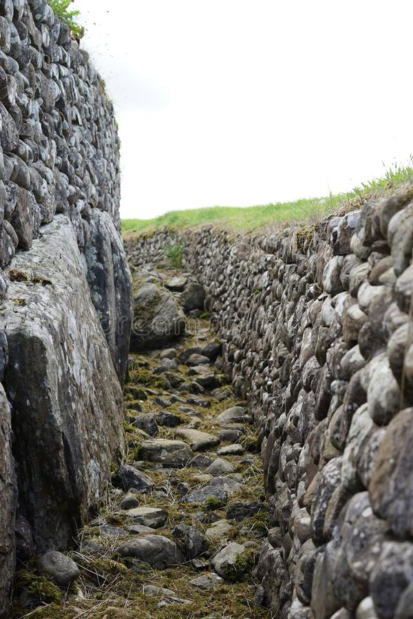 Newgrange megalithic passage tomb outer wall. The passage tomb at Newgrange known as Brú na Bóinne in Gaelic served as a focus of ceremonial activity in stock photos