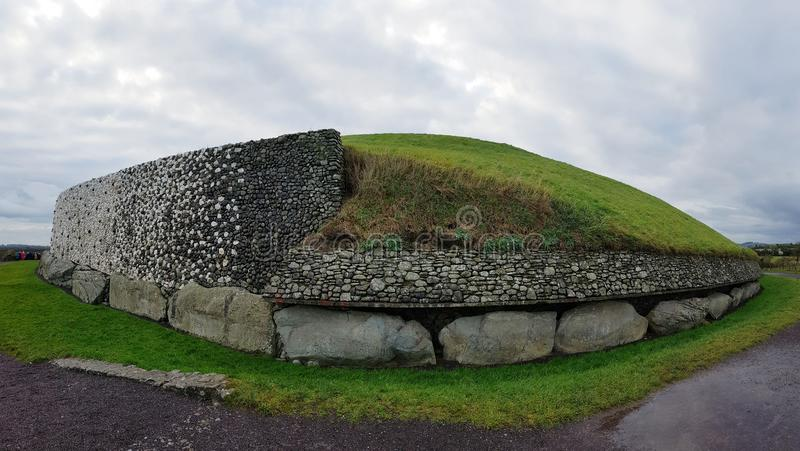 Newgrange monument. Newgrange is a prehistoric monument in County Meath, Ireland, located 8 kilometres west of Drogheda on the north side of the River Boyne. It stock photography
