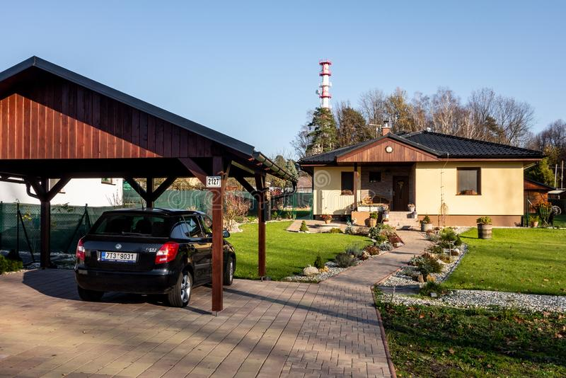 A newly built family house with a wooden garage and a black car stock images