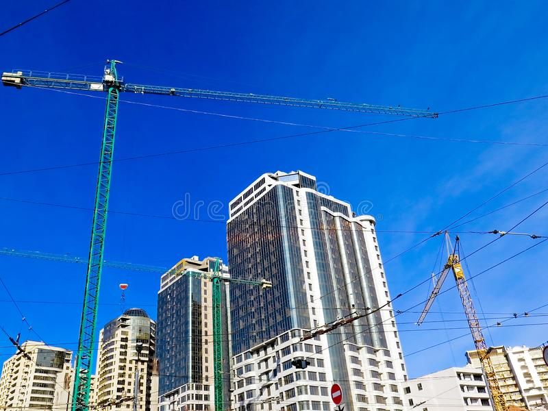Newly built houses in the newly built area of the city. Perspective construction of apartments. Infrastructure and industry. Family Housing royalty free stock images