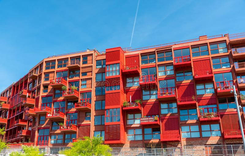 Newly built red multi-family apartment house. Seen in Berlin, Germany stock photo