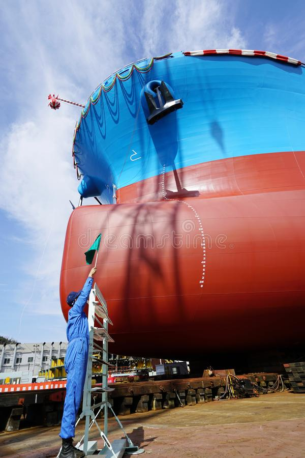 Newly built vessel launching of the shipyard. Newly built vessel during launching of the shipyard in Japan stock photos