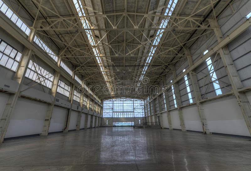 Newly constructed empty warehouse/factory. During the day, filled with natural light royalty free stock photography