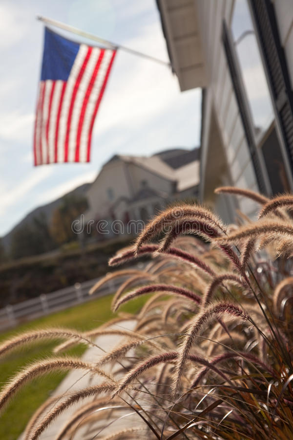 Newly Constructed Modern Home Abstract. Modern Home Yard Abstract with American Flag royalty free stock photos
