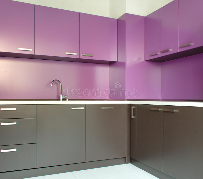 Newly fitted modern kitchen. In purple and brown royalty free stock images