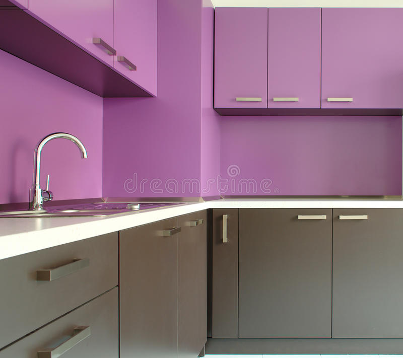 Newly fitted modern kitchen. In purple and brown royalty free stock image