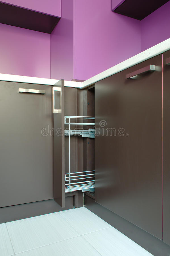 Newly fitted modern kitchen. In purple and brown royalty free stock photography
