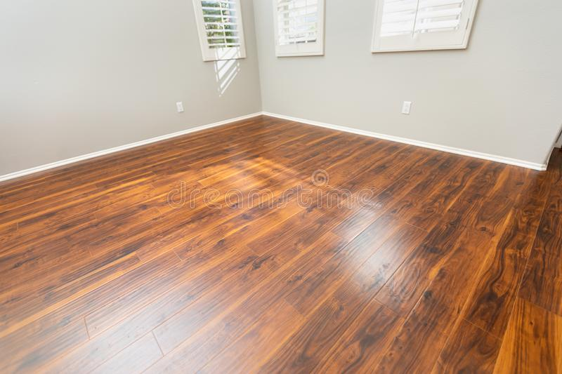Newly Installed Brown Laminate Flooring and Baseboards in Home.  stock image