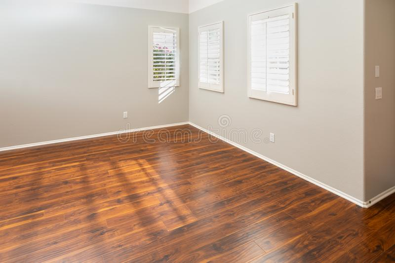 Newly Installed Brown Laminate Flooring and Baseboards in Home.  royalty free stock photo