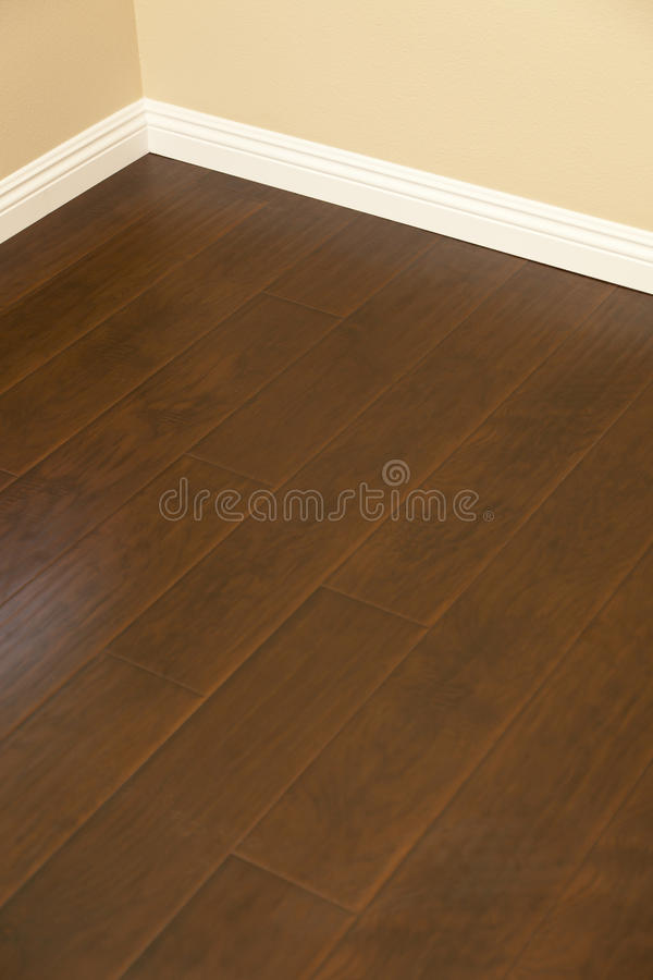 Newly Installed Brown Laminate Flooring and Baseboards in Home. Beautiful Newly Installed Brown Laminate Flooring and Baseboards in Home royalty free stock photo