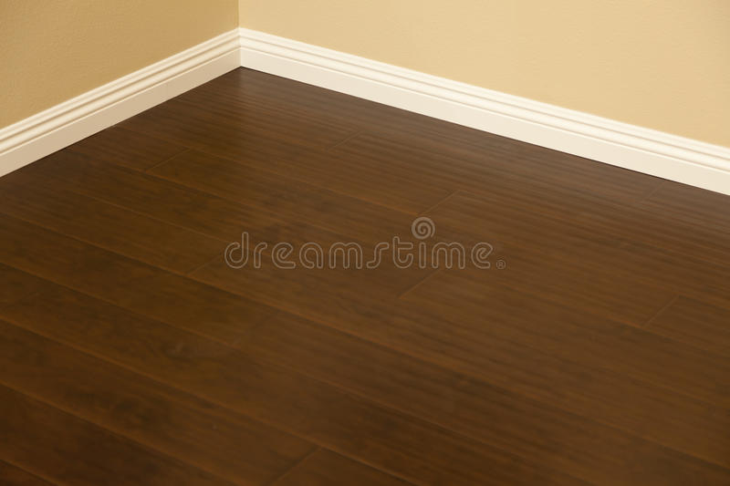 Newly Installed Brown Laminate Flooring and Baseboards in Home. Beautiful Newly Installed Brown Laminate Flooring and Baseboards in Home stock photography