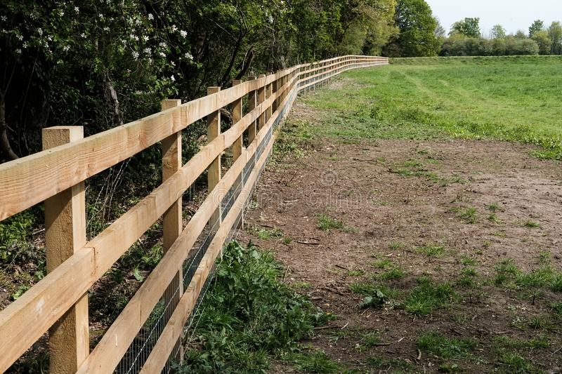 Newly installed, timber fencing used to section off a large paddock uses for horses. stock photos