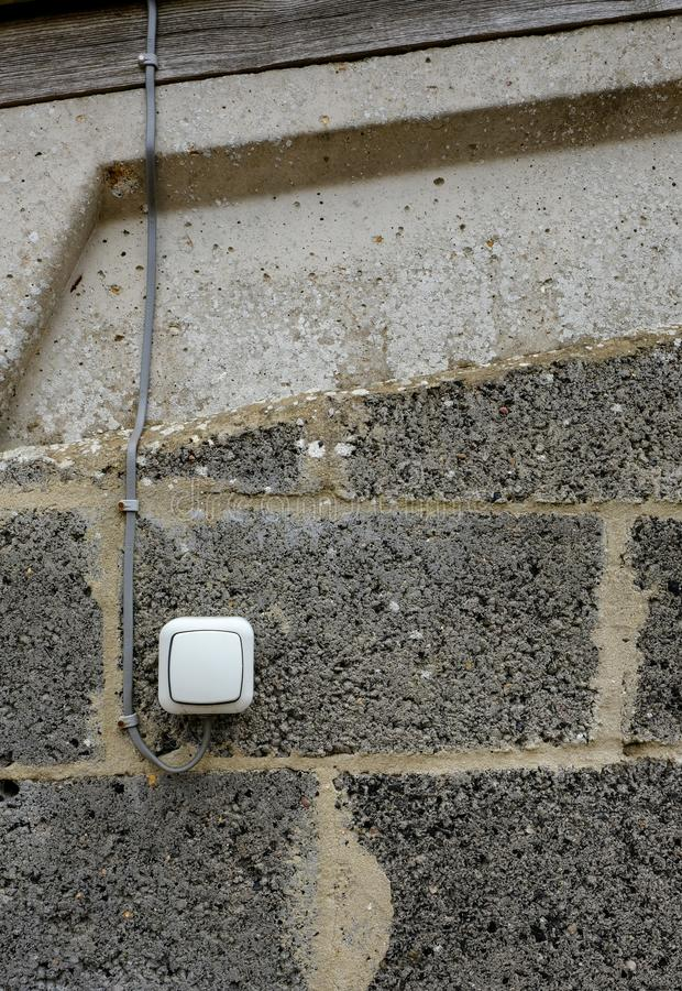 Newly installed, water-resistance On/Off switch for lighting in a horse stable. stock photo