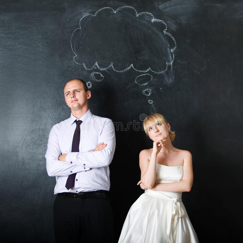 Newly-married couple. Groom and the bride, together make plans, concept. stock image