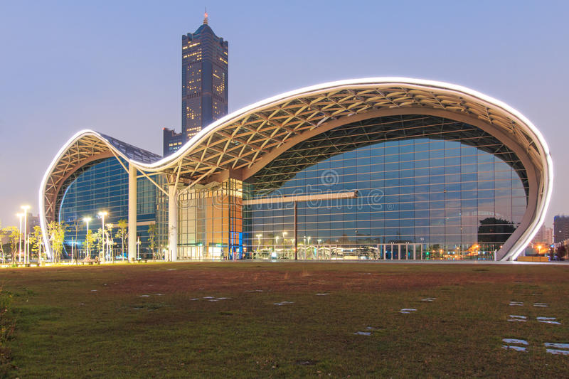 The newly opened Kaohsiung Exhibition Center and the 85 Building on background. Kaohsiung, Taiwan - December 18, 2014: The newly opened Kaohsiung Exhibition royalty free stock photography