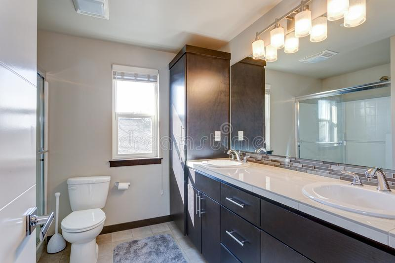 Newly renovated bathroom in apartment building. With dual vanity cabinet stock photo