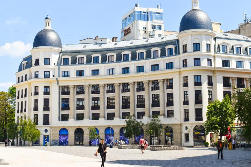 Newly restaurated neo classical architecture building in The University Square or Piata Universitatii in downtown of Bucharest. royalty free stock image