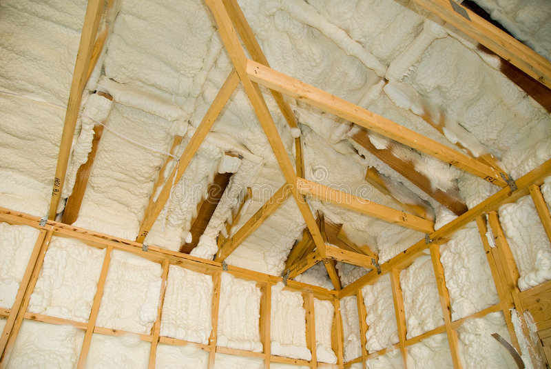 Newly sprayed insulation stock image