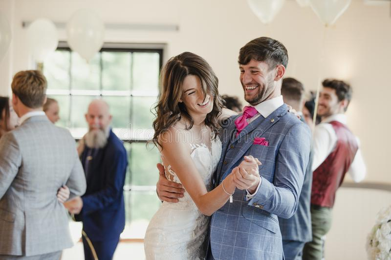 Newly Wed Couple Dancing With Their Guests. Newly wed couple are dancing together on their wedding day with all of their guests stock images