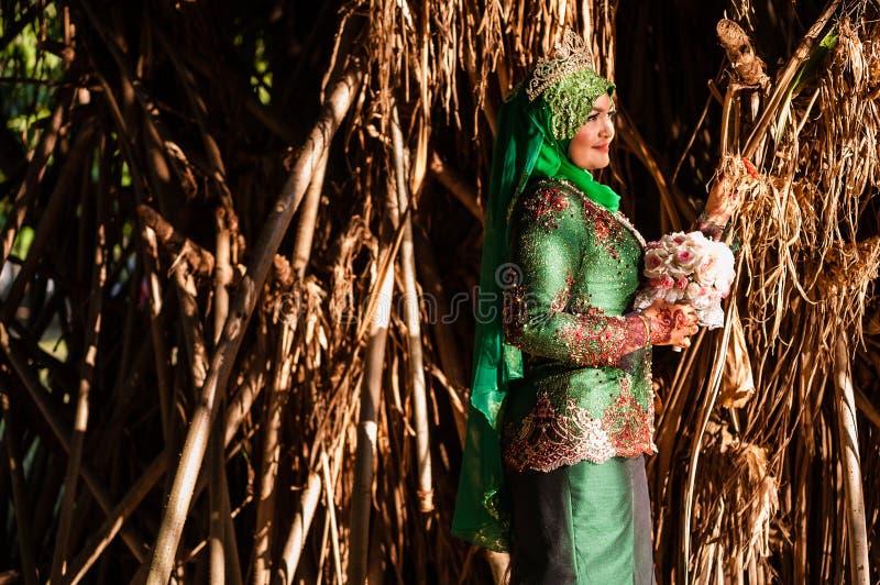 Newly wedded bride posing royalty free stock image