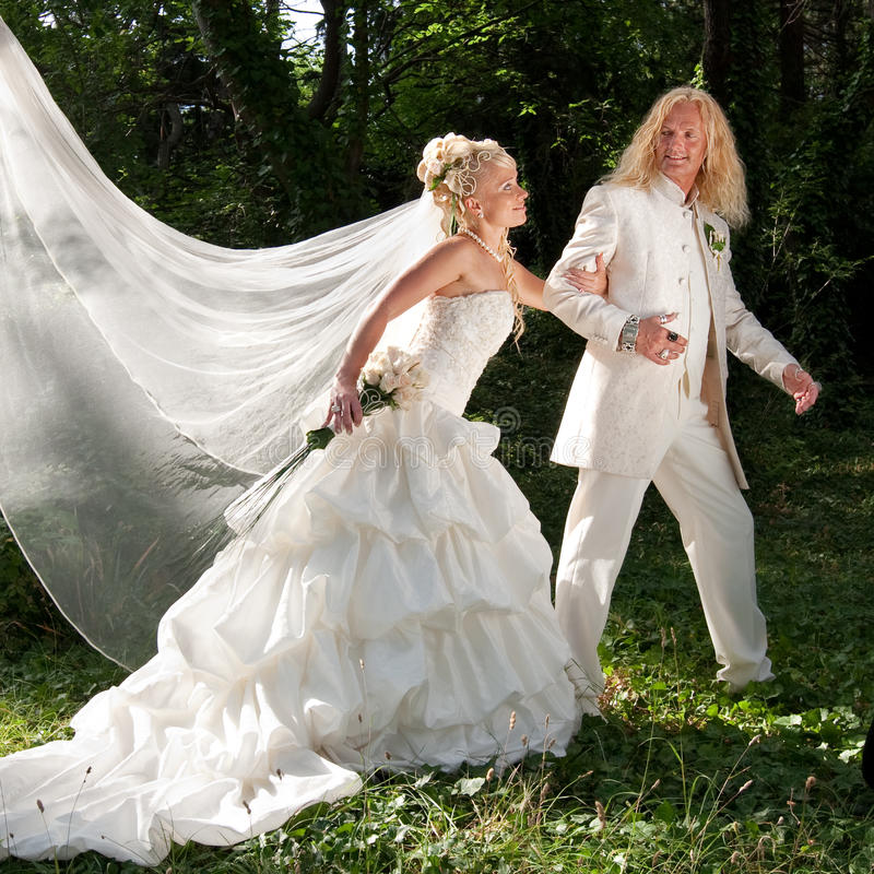 Download Newly Wedded Couple In The Park Stock Photography - Image: 18121972