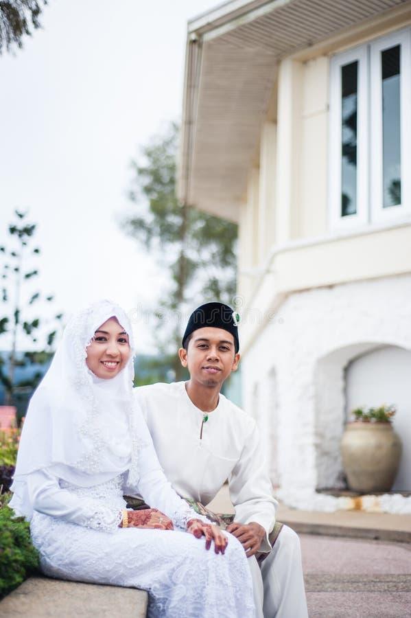 Newly wedded couple posing stock photo