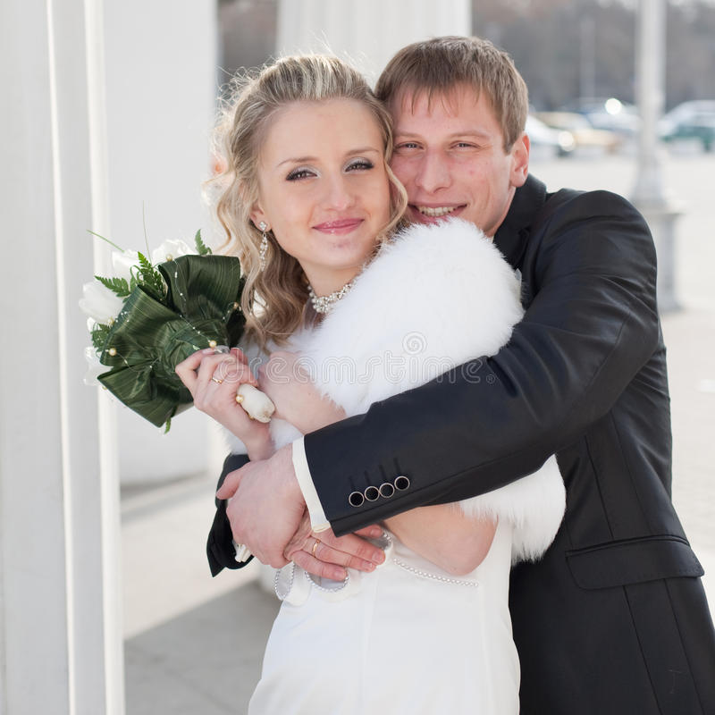 Newly Wedded Looking At Camera Smiling Stock Images