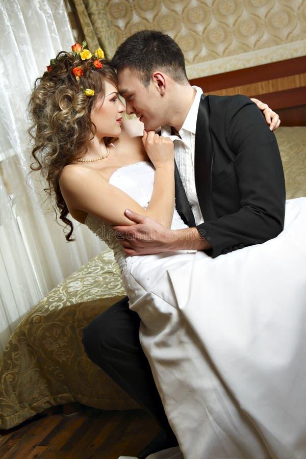 Newly wedding couple. Very romantic intimate surroundings between newly wedding couple stock photos