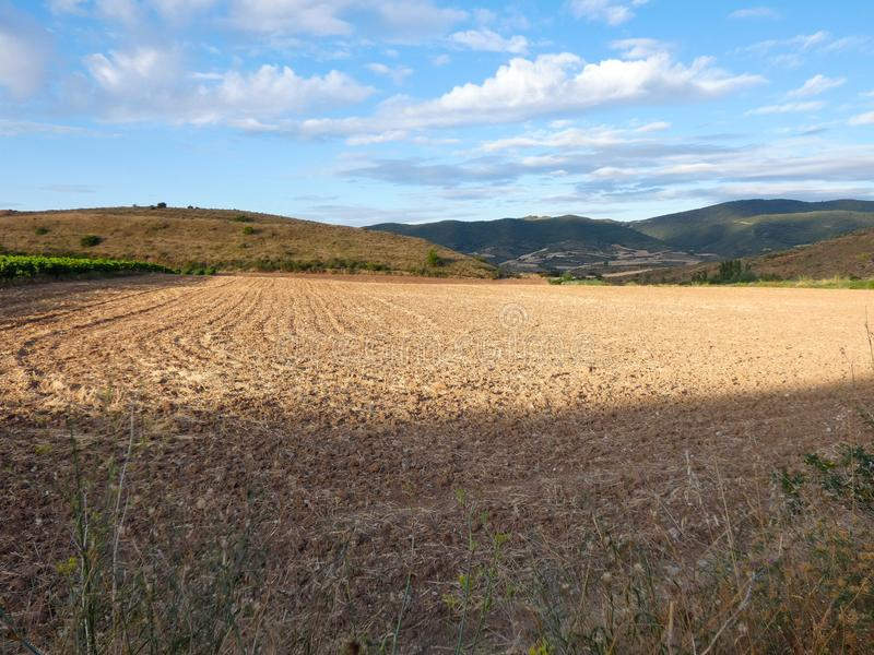 Fields of Spain in Summer, recently reaped and worked. Newly worked land, freshly harvested and prepared for the next harvest stock photo
