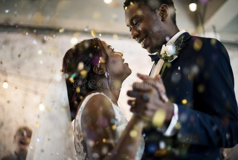 Newlywed African Descent Couple Dancing Wedding Celebration royalty free stock image