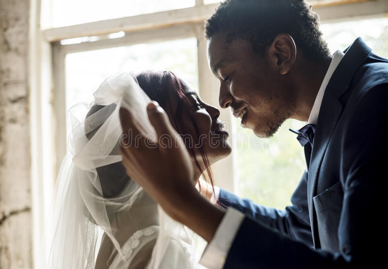 Newlywed African Descent Groom Open Bride Veil Wedding Celebration royalty free stock photos