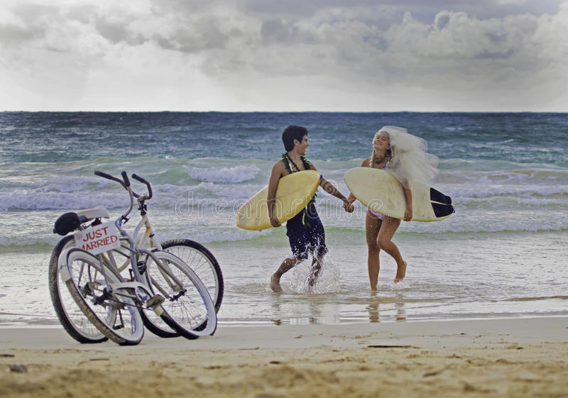 Newlywed couple on the beach royalty free stock photos