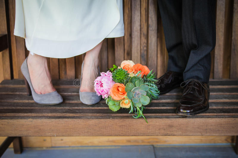 Newlywed couple with bouquet stock photo