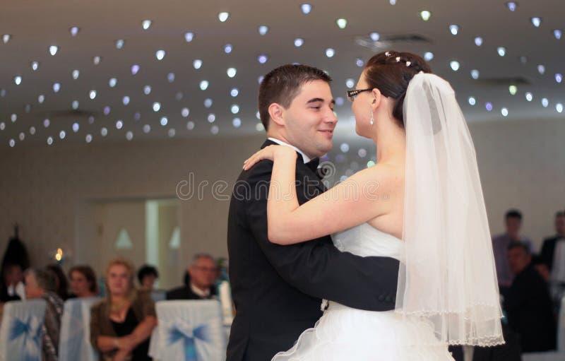 Newlywed couple dance stock photo