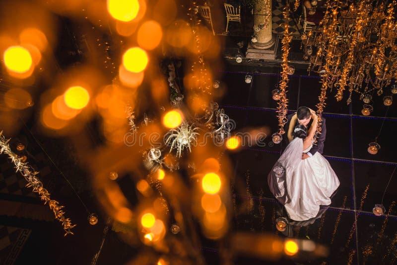 Newlywed couple dancing first dance, bride and groom waltz dancefloor royalty free stock photo