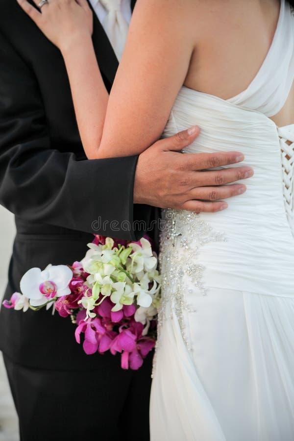 Newlywed couple embracing stock photo