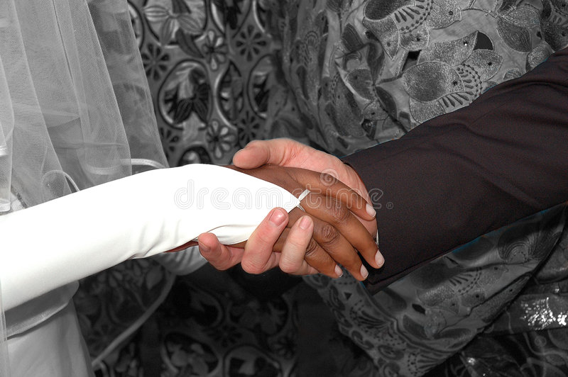 Download Newlywed Couple Holding Hands Stock Photo - Image: 1084046