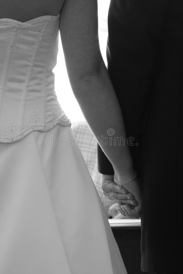 Newlywed couple holding hands royalty free stock photo