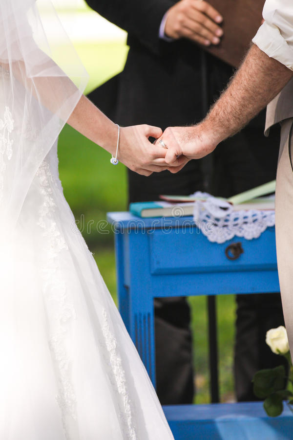Newlywed couple holding hands royalty free stock image