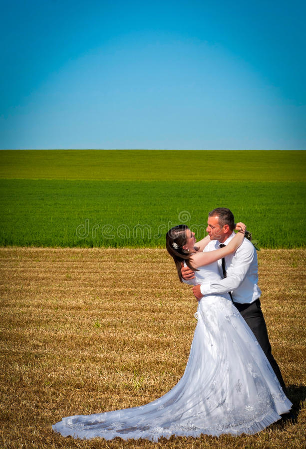 A newlywed couple hugging stock photos