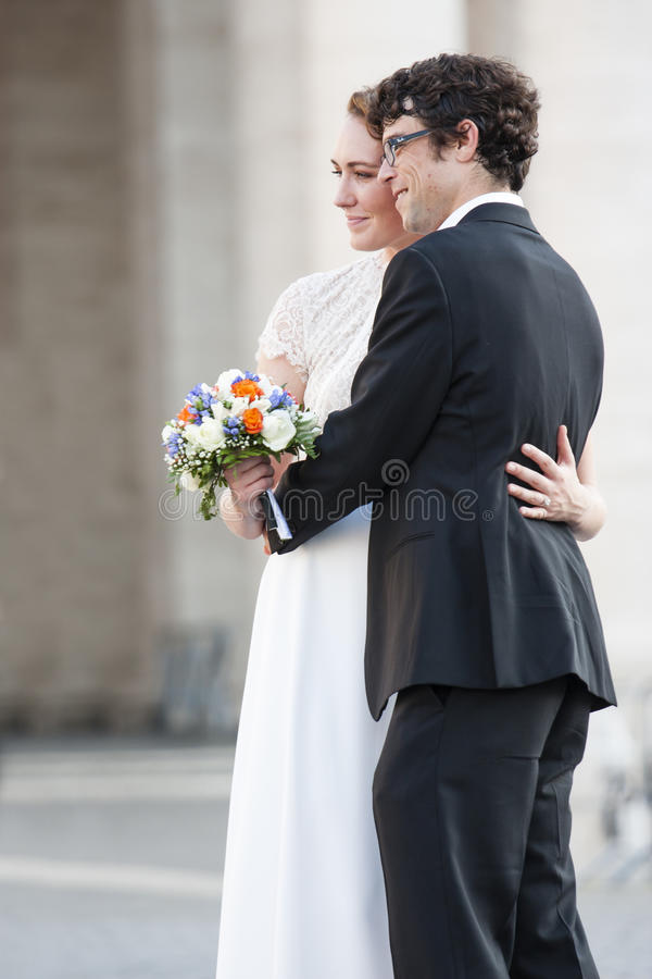 Newlywed couple hugging royalty free stock photography