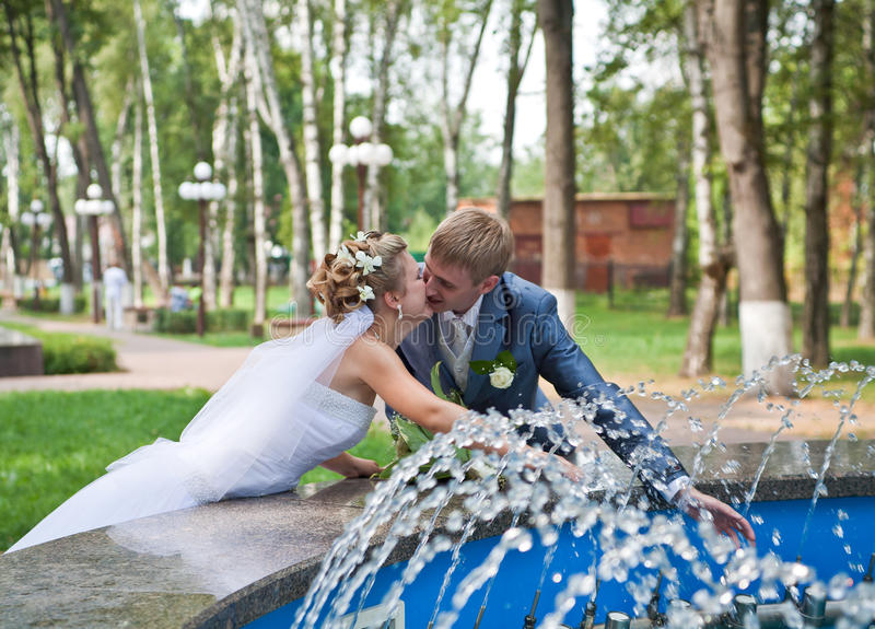 Download Newlywed Couple Kissing Near Fountain Stock Photography - Image: 16065672
